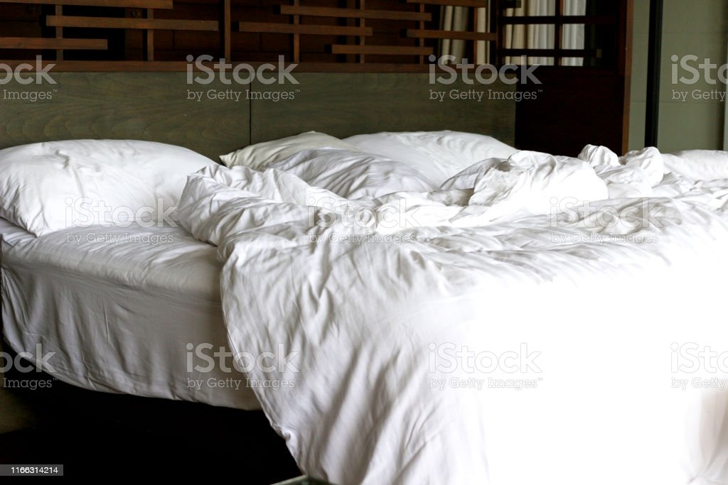 Bed sheet in hotel mess after customers left