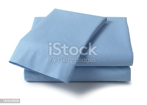 Set of blue bed sheets on white with drop shadow.  A path is included.