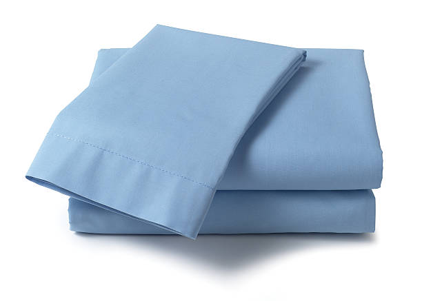 bed sheets - folded stock photos and pictures