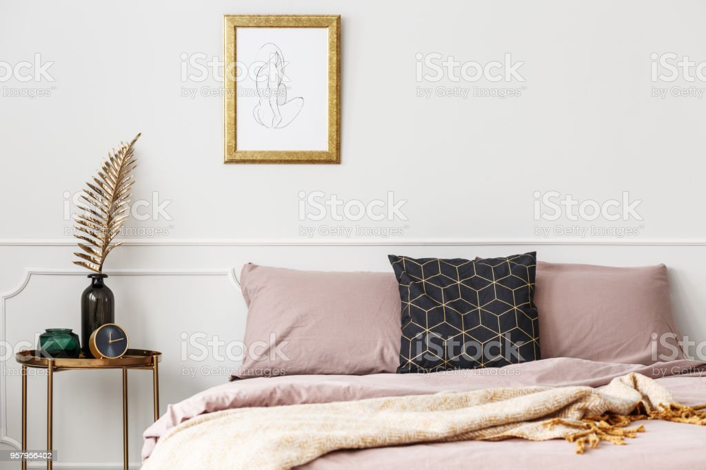 Bed with pink bedding stock photo