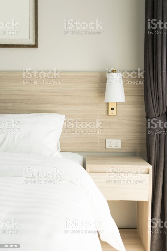Bed with white pillows and white sheets royalty-free stock photo