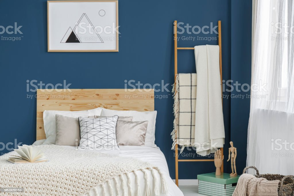 Bed with wooden bedhead stock photo