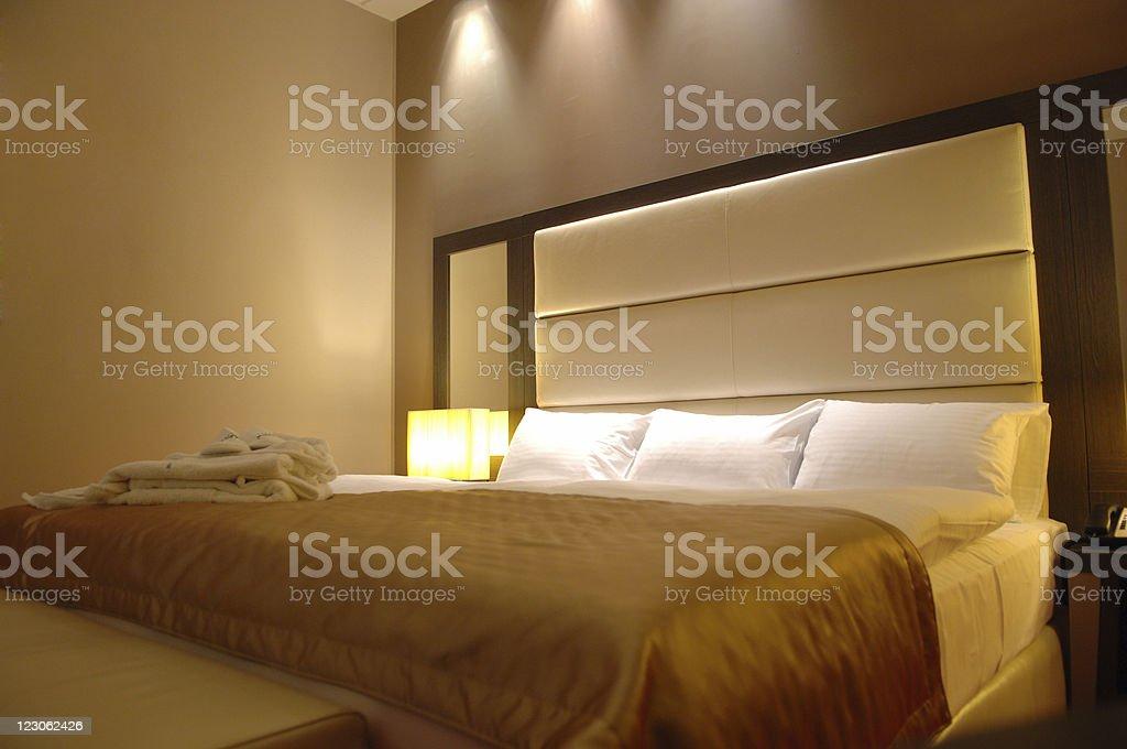 Bed with yellow  iluminance royalty-free stock photo