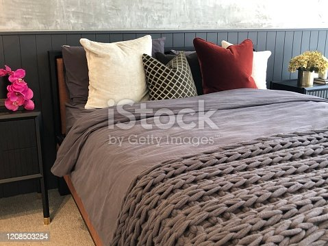 Close up of soft fluffy cushions on a comfortable bed