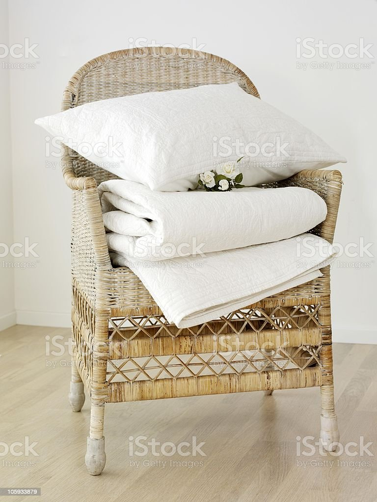 sheet and pillow on a bamboo chair