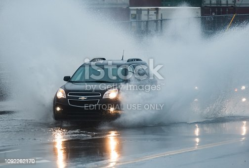 Halifax, Canada - January 9, 2019 - The driver of a Chevrolet SUV navigates a flooded portion of the Bedford Highway after heavy rains.