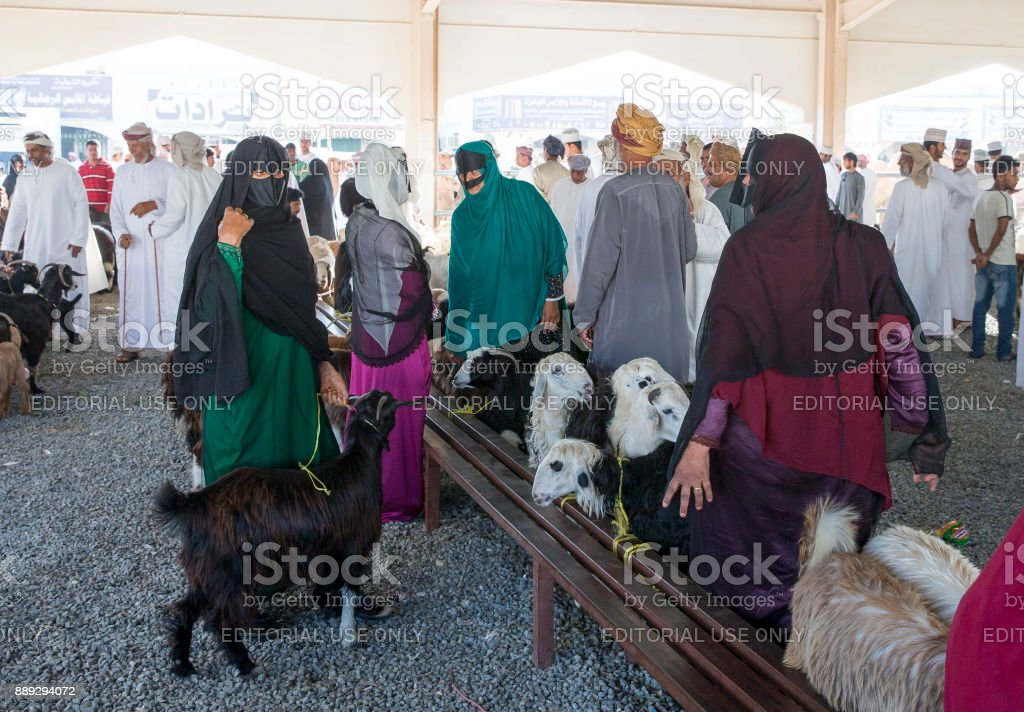 bedhouin people at a goat market stock photo