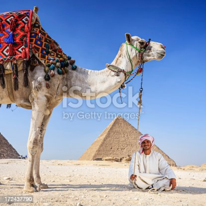 istock Bedouin and pyramids 172437790