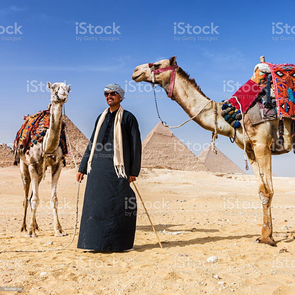 Bedouin and pyramids stock photo