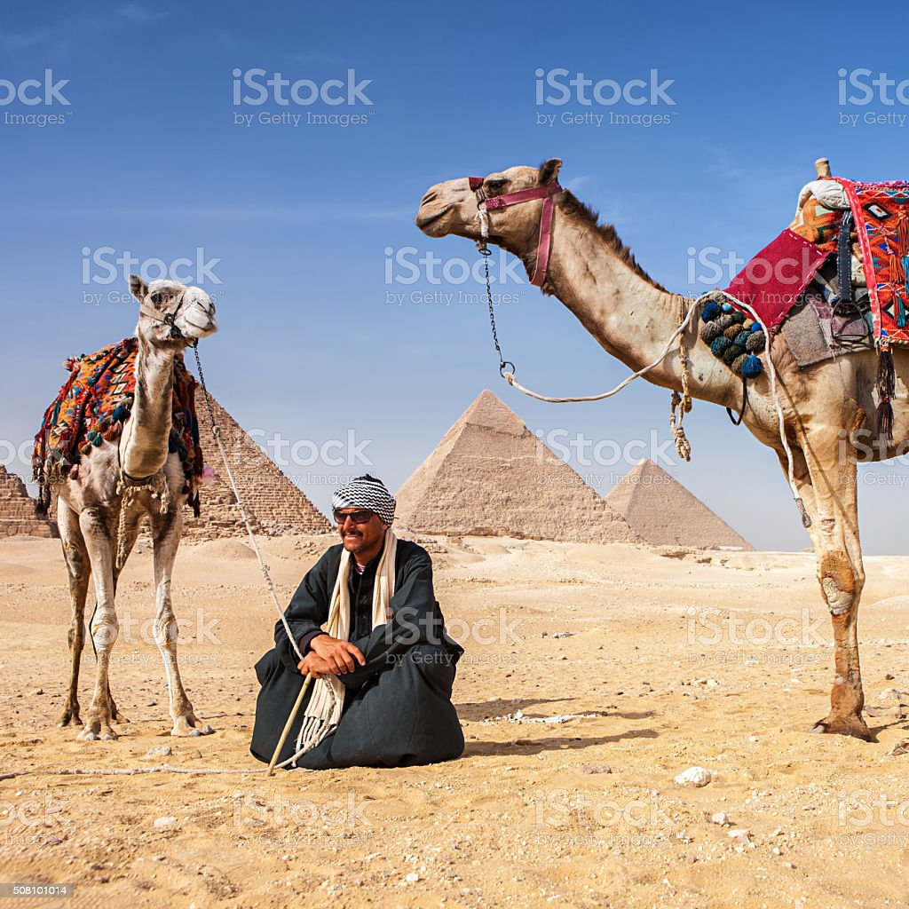 Bedouin and pyramids stock photo