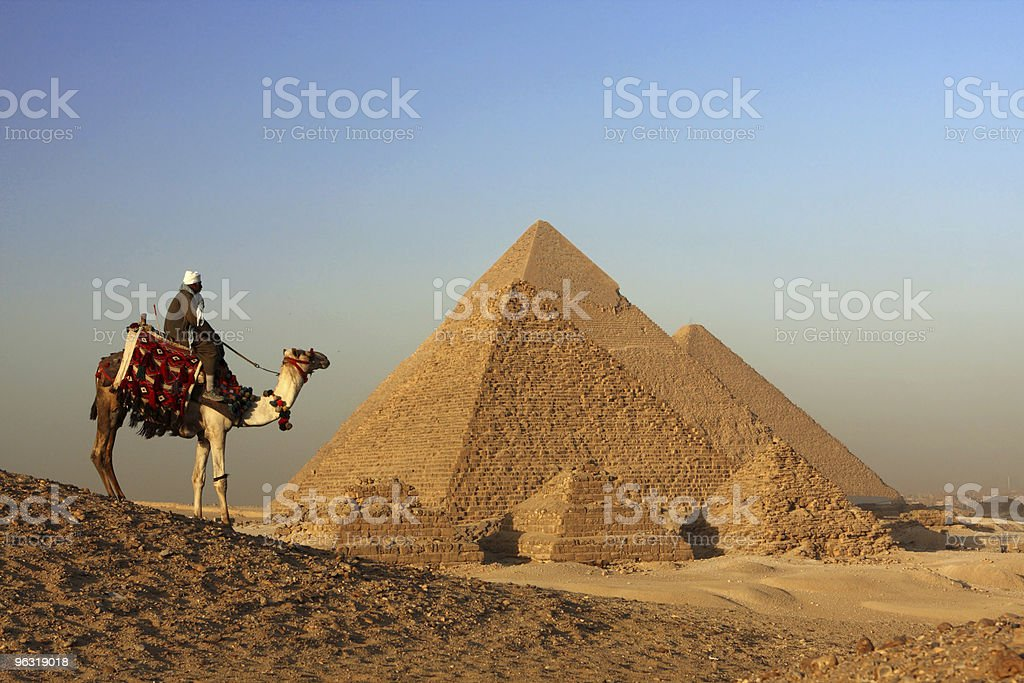 bedouin and pyramids royalty-free stock photo
