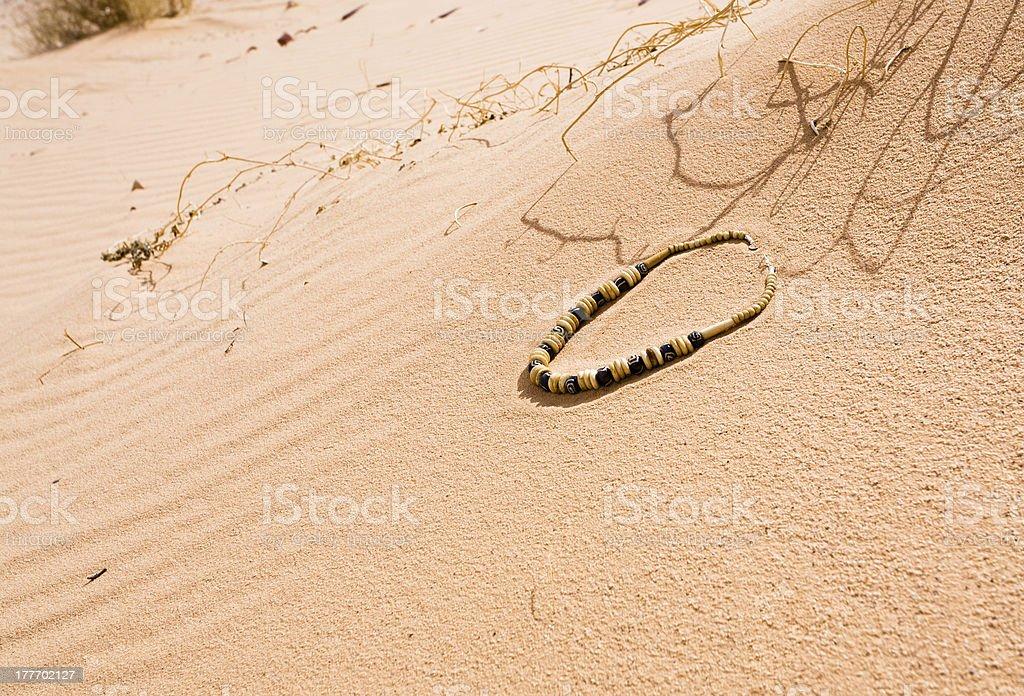 Bedouin beads on red sand dune dessert royalty-free stock photo