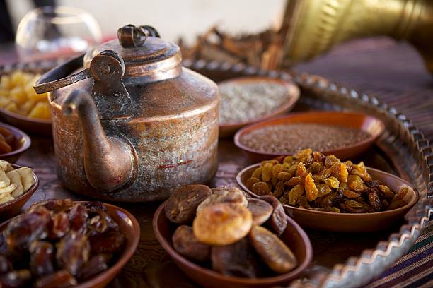 bedouin tea, nuts and dried fruit - ramadan stock photos and pictures