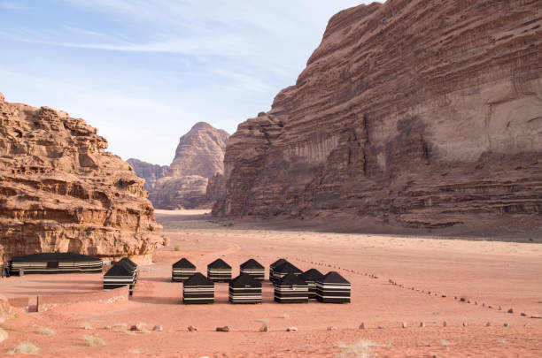 Bedouin tourist black tents in the Wadi Rum desert in Jordan Bedouin tourist black tents in the Wadi Rum desert in Jordan riverbed stock pictures, royalty-free photos & images