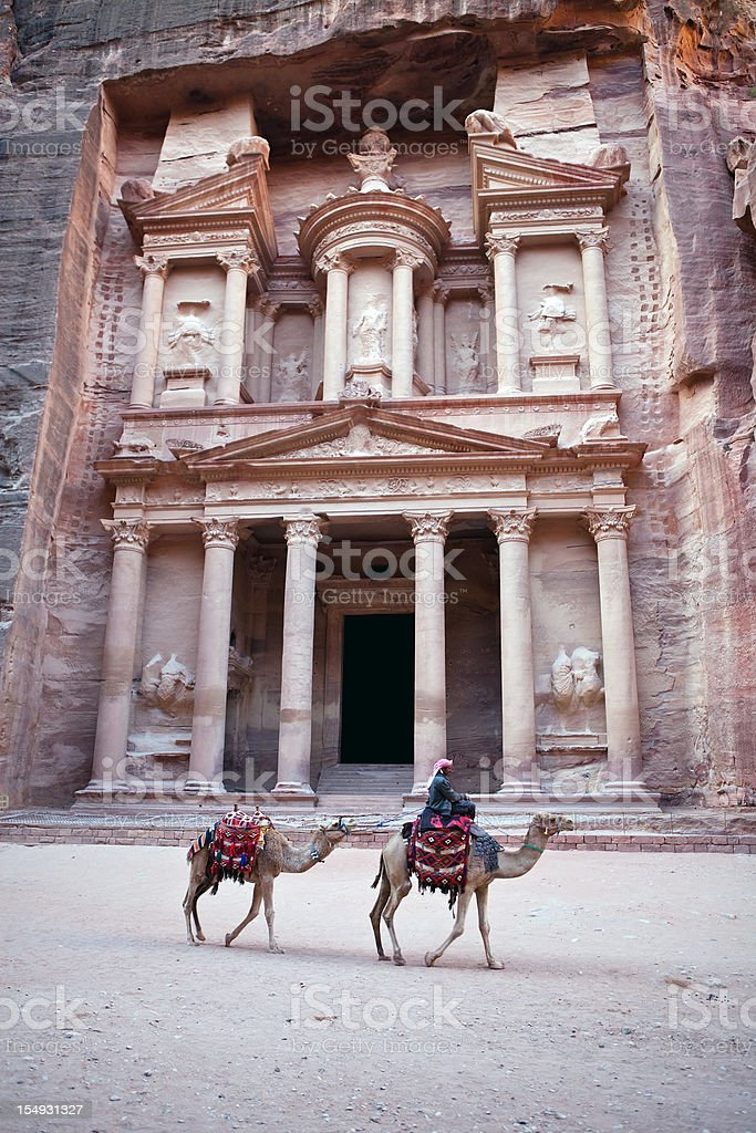 Bedouin with his camel at The Treasury,El Khazneh stock photo