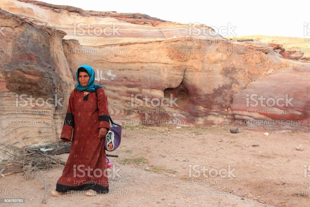 pretty nice 7317b b656a Bedouin Woman carrying her baby wrapped in blanket, Petra, Jordan royalty-free  stock