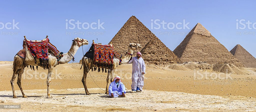 Bedouins and pyramids royalty-free stock photo