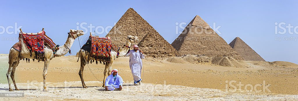 Bedouins and pyramids stock photo