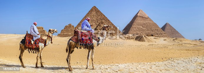 883177796istockphoto Bedouins and pyramids 182062470