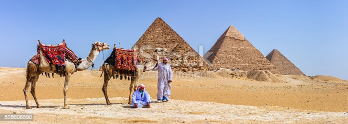 istock Bedouins and pyramids 528606590