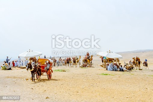 883177796 istock photo Cairo, Egypt - August 13, 2006: Bedouins with camels in desert Sahara. Giza. Egypt. UNESCO World Heritage 684252022