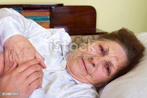 istock Bedridden elderly woman 810857312
