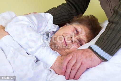 istock Bedriedden elderly woman 810857274