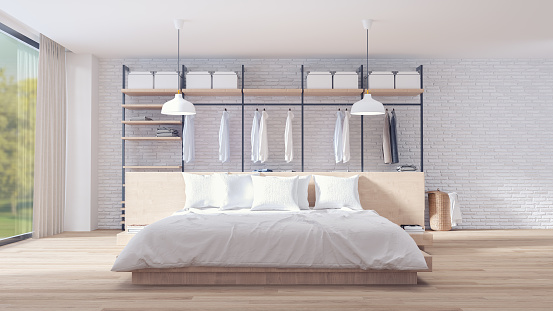 istock Bedroom and dressing room loft style interior design , wood bed and wood wardrobe furniture ,white brick wall and parquet floor ,3d rendering 933373482