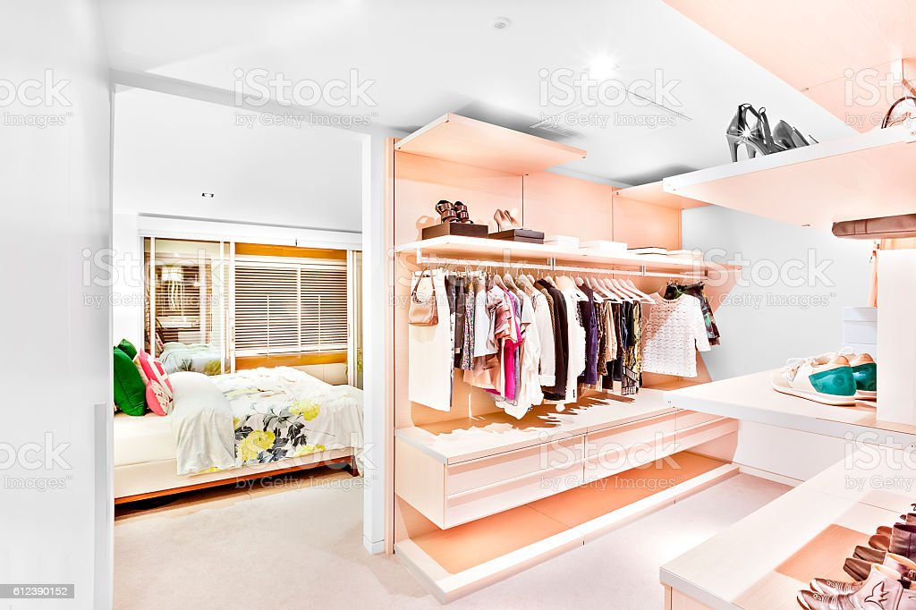 Bedroom attached to the garment store room of a house stock photo