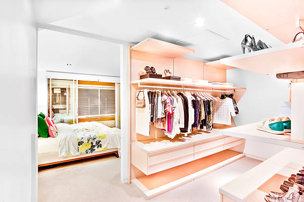 bedroom attached to the garment store room of a house - garderobe mit schuhschrank stock-fotos und bilder