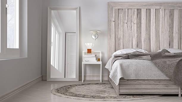DIY bedroom, bed with wooden headboard, scandinavian white eco c stock photo
