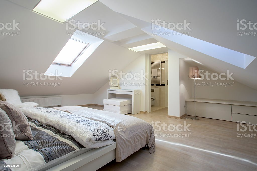 Bedroom connected with bathroom stock photo