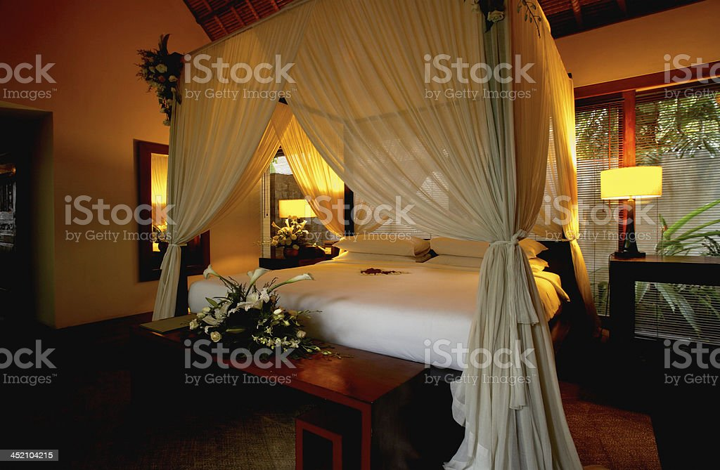 Bedroom decorated with flowers We have taken the image of a tropical hotel. Bali Stock Photo