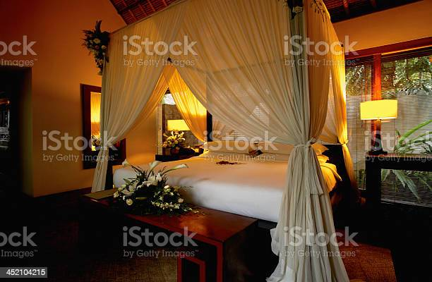Bedroom Decorated With Flowers Stock Photo - Download Image Now
