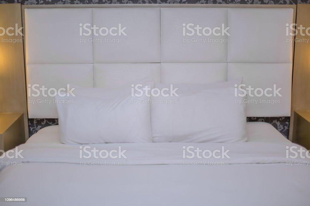 Bedroom Furniture King Size Bed In Clean White Beddings And Pillows With Bedside Lamps Stock Photo Download Image Now Istock