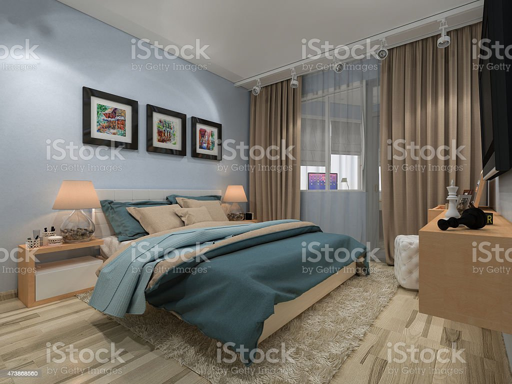 Bedroom in a private house in blue and beige colors stock photo