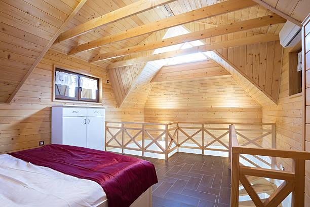 bedroom in modern style log house - bett landhausstil stock-fotos und bilder