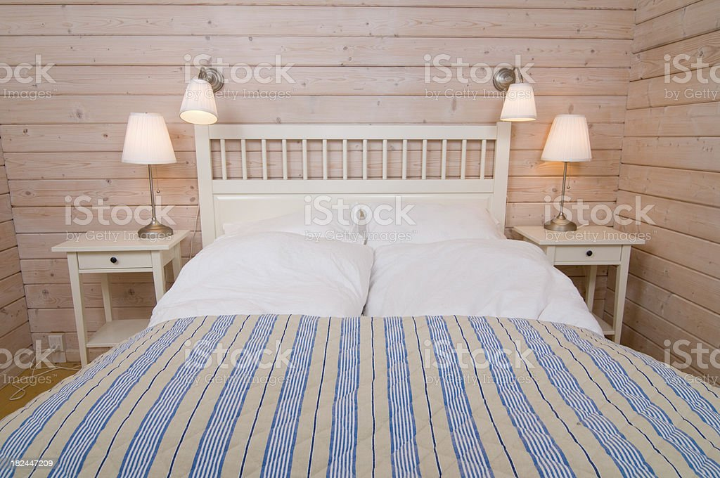 Bedroom in scandinavian style with wood walls royalty-free stock photo