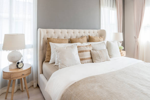 Bedroom in soft light colors big comfortable double bed in elegant picture id835932468?b=1&k=6&m=835932468&s=612x612&w=0&h=8ibtso5zhmlxa9o8tfahuqmjgbw8trxd 9nrjnozjhw=