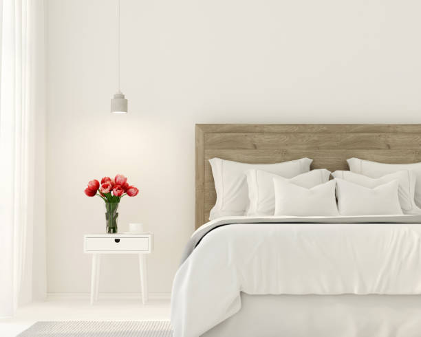 Bedroom in white color 3D illustration. Interior of the bedroom in white color and with tulips on the bedside table bed furniture stock pictures, royalty-free photos & images