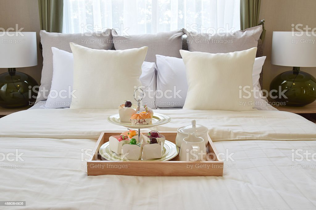 bedroom interior design with decorative set on bed stock photo