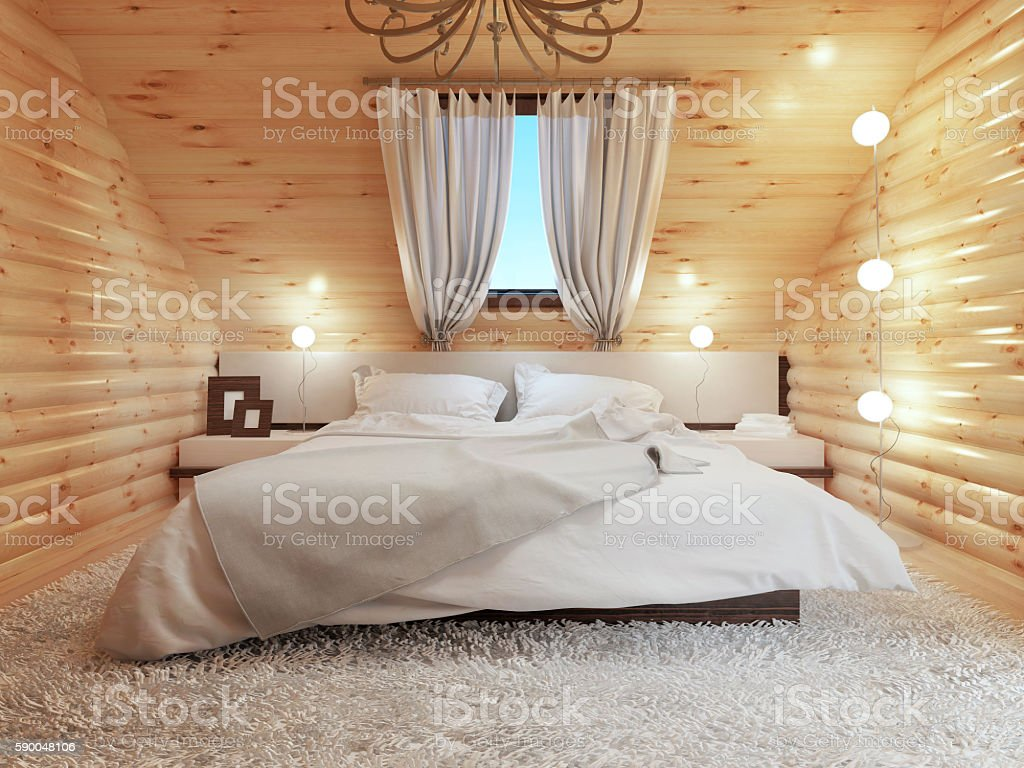 Bedroom interior in a log on the attic floor stock photo