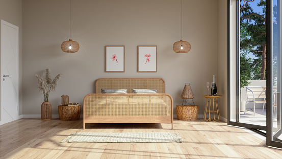 Bedroom Interior In Beige Color With Wicker Bed Furniture, Pendant Lights, Balcony And Posters On The Wall.