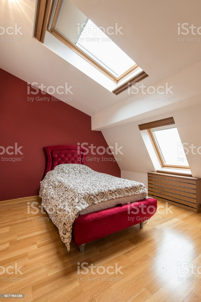 Bedroom interior in luxury red loft, attic, apartment with roof...