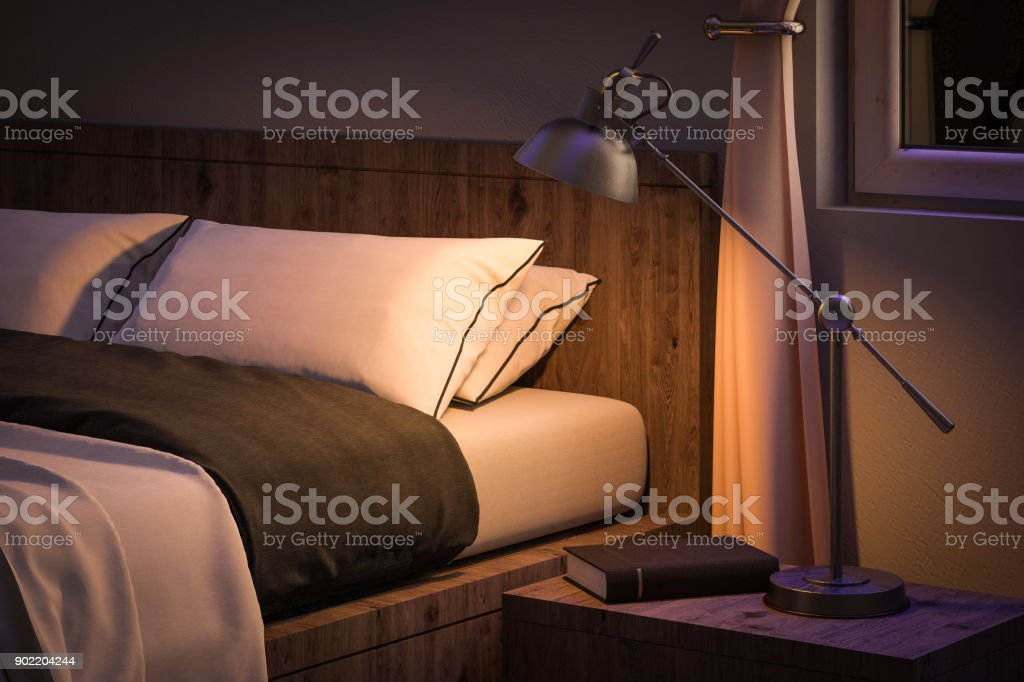 bedroom interior with book and reading lamp stock photo
