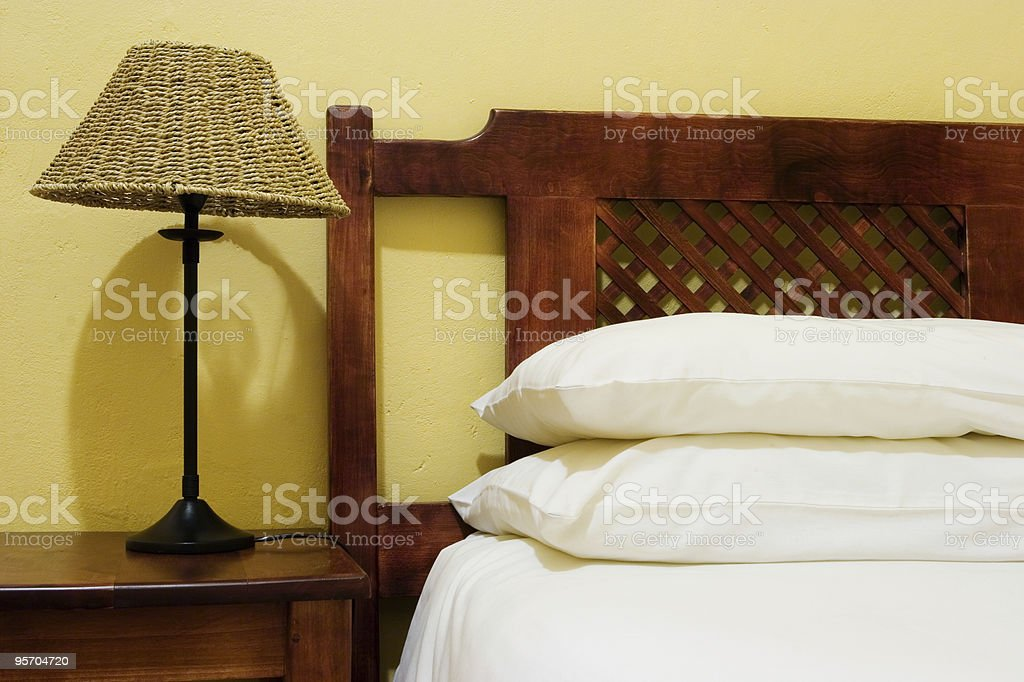 Bedroom interior with lamp and bedpost royalty-free stock photo