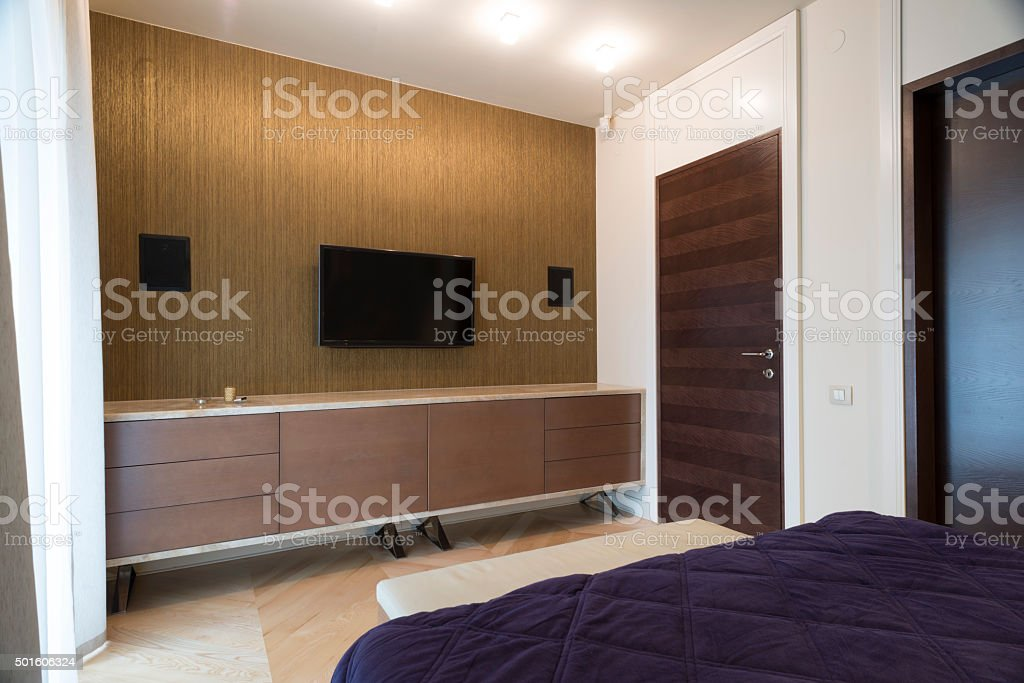 Bedroom Interior With Wall Mounted Tv And Speakers Royalty Free Stock Photo