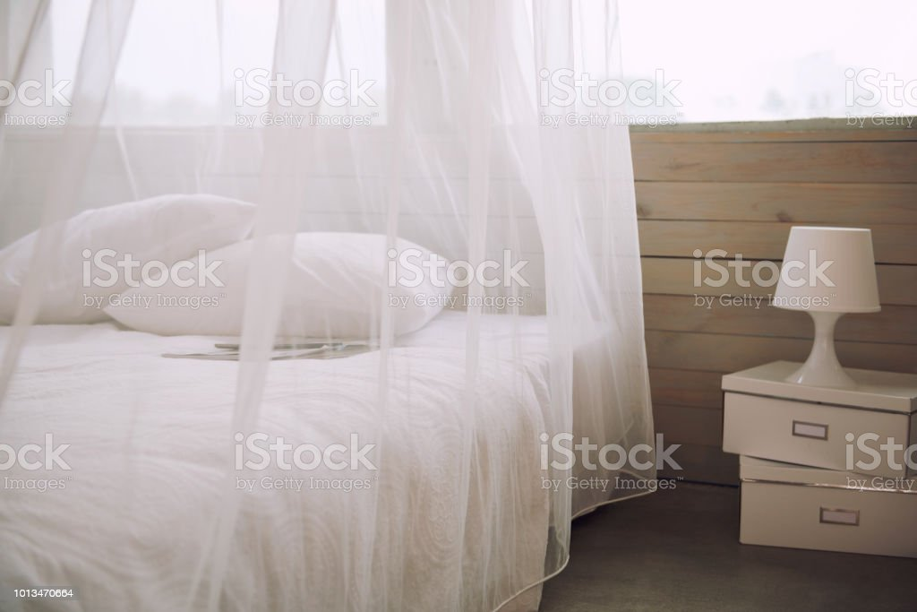 Bedroom interior with white beddings in apartment, nobody.
