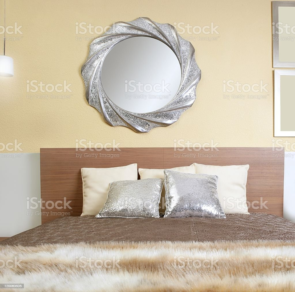 bedroom modern silver mirror fake fur blanket stock photo