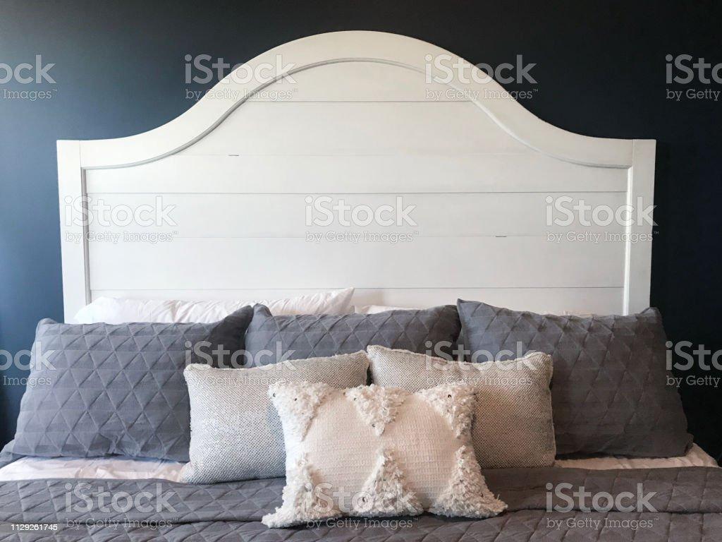 bedroom with shiplap headboard
